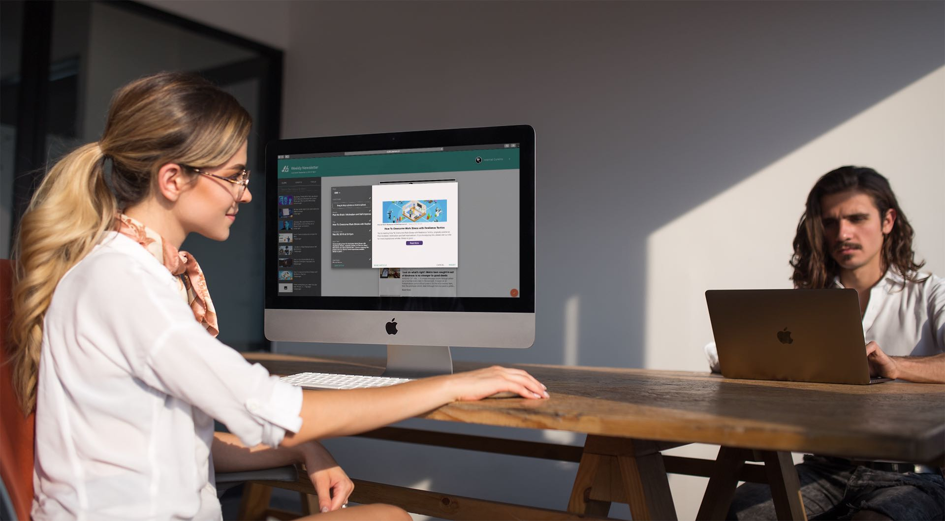 girl-working-with-an-imac-mockup-near-her-coworker-a20982