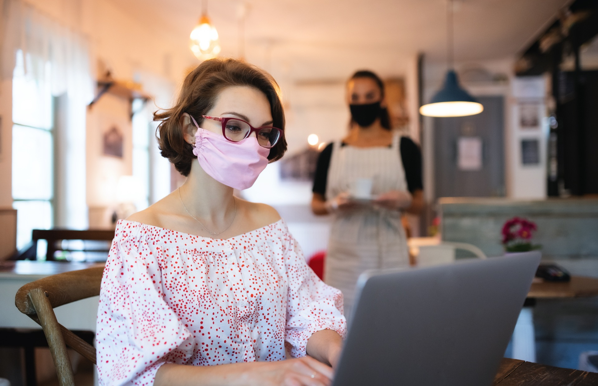 young-woman-with-face-mask-and-laptop-indoors-in-c-WBWWXGA