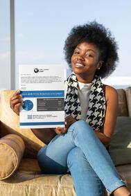 Woman with a printed total reward statement